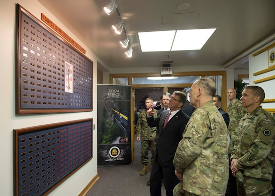 Defense Secretary Ash Carter stops to read the wall acknowledging the fallen troops of I Corps during a visit to Joint base Lewis-McChord, Wash., March 4, 2016. DoD photo by Navy Petty Officer 1st Class Tim D. Godbee