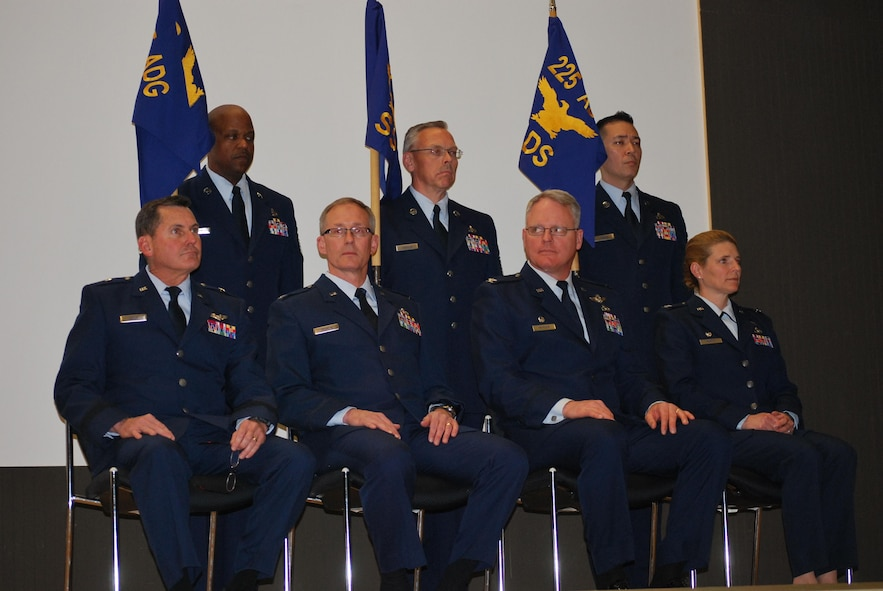 Western Air Defense Sector leaders gather during the activation and assumption of command ceremony, Joint Base Lewis-McChord, May 2, 2015. WADS is responsible for air sovereignty and counter-air operations over the western United States and directs a variety of assets to defend 2.2 million square miles of land and sea. (U.S. Air National Guard photo by 1st Lt. Colette D. Muller/Released)