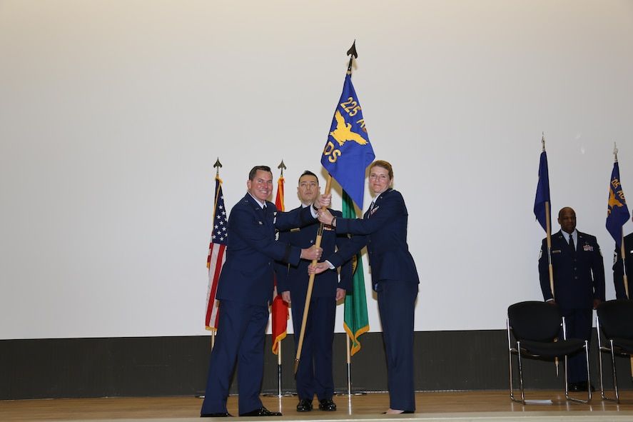 Western Air Defense Sector, Director of Support, Col. Paige T. Abbott, receives the 225th Air Defense Squadron guidon from Brig. Gen. John S. Tuohy, Washington state assistant adjutant general - Air, during the activation and assumption of command ceremony, Joint Base Lewis-McChord, May 2, 2015. WADS is responsible for air sovereignty and counter-air operations over the western United States and directs a variety of assets to defend 2.2 million square miles of land and sea. (U.S. Air National Guard photo by Capt. Kimberly Burke/Released)