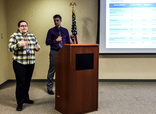 Megan Garrett and Ken Baldauff, members of the district's 2016 Leadership Development Program, present the Action Plan to the district senior leadership during the Feb. 19, leadership workshop.