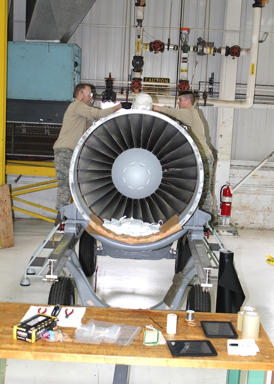 Tech. Sgt. Richard Coleman and Tech. Sgt. Andrew Rudolph prepare a jet engine for shipment, March 5, 2016. Coleman and Rudolph are both aerospace propulsion specialists with the 127th Maintenance Squadron at Selfridge Air National Guard Base. (U.S. Air National Guard photo by Tech. Sgt. Dan Heaton)