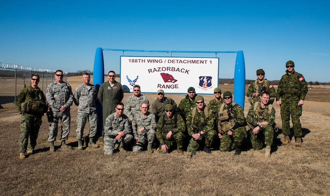 Airmen of the 188th Wing and members of the 2nd Regiment Royal Canadian Horse Artillery gather together as a group Feb. 10, 2016, during training held at Razorback Range, Fort Chaffee Joint Maneuver Training Center, Fort Smith, Ark. Canadian JTACs are required to train abroad at least twice a year and chose to come to Razorback Range to benefit from the wealth of training opportunities provided there. (U.S. Air National Guard photo by Senior Airman Cody Martin/Released)