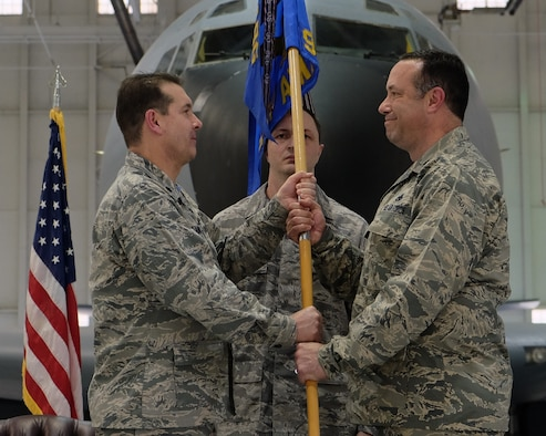 Lt. Col. Chris W. Labrum, left, 931st Air Refueling Wing deputy commander for maintenance, passes the 931st Aircraft Maintenance Squadron guidon to Lt. Col. Eric Eggers, incoming 931 AMXS commander, during the 931 AMXS change of command ceremony March 6, 2016, McConnell Air Force Base, Kansas. This is first change of command since the 931 ARW was redesignated from a group to a wing. (U.S. Air Force photo by Senior Airman Preston Webb)