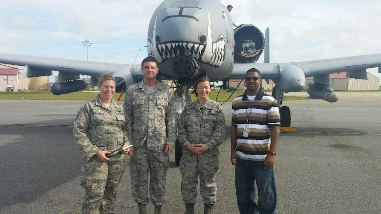 PATRICK AIR FORCE BASE, Fla. – (Left to right) Master Sgt. Michelle St. Laurent, 920th Communications Flight radio frequency transmission section chief, Senior Master Sgt. Timmy Gray, 920th CF superintendent, Col. Jeanne Bisesi, 920th Mission Support Group commander, and Mr. James Bailey, 920th CF network system administrator, stand in front of an A-10 Thunderbolt II aircraft, Feb. 4, here.  St. Laurent and Bailey were recognized for their responsiveness and outstanding communications support for the visiting A-10 Thunderbolt II crew.  (Courtesy photo)
