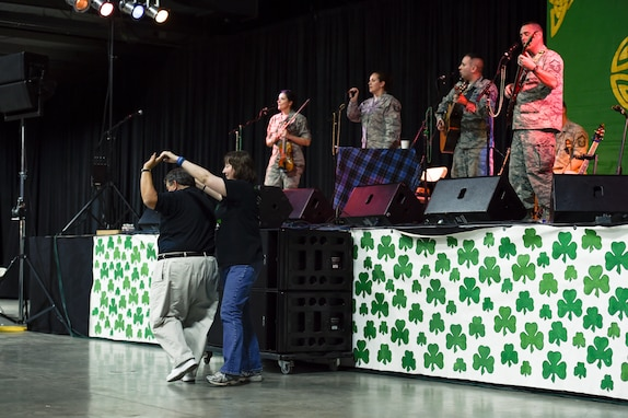 "North Texas Irish Festival attendees dance during a performance by the U.S. Air Force's Celtic Aire in Dallas, Texas, March 5, 2016. This year's festival was themed ""Legends and Legacy"" to highlight some of the true legends of Irish music as well as emerging musicians. (U.S. Air Force photo/Senior Airman Ryan J. Sonnier/RELEASED)"