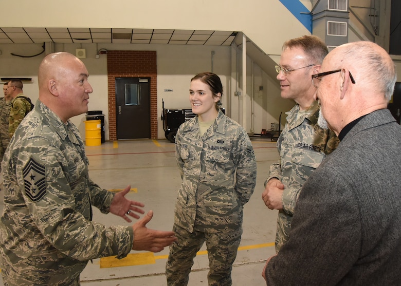The National Guard's senior enlisted adviser, Command Chief Master Sgt. Mitchell O. Brush, visits with service members and their families during his tour of the South Dakota Air National Guard at Joe Foss Field, March 5, 2016. Members of the 114th FW and their families were given the opportunity to share their concerns and issues with Brush who advises the Chief of the NGB on all enlisted matters affecting training, effective utilization, health of the force, and enlisted professional development. (U.S. Air National Guard photo by Staff Sgt. Luke Olson/Released)