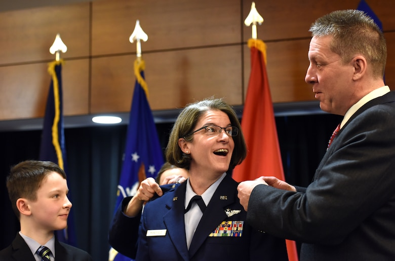 JOINT BASE ELMENDORF-RICHARDSON, Alaska -- New Brig. Gen. Karen Mansfield, commander of the Alaska Air National Guard, receives her general's stars from family members in a ceremony at the Arctic Warrior Events Center here March 6, 2016. Mansfield became the third female general officer in the history of the Alaska Air National Guard. National Guard photo by Capt. John Callahan.