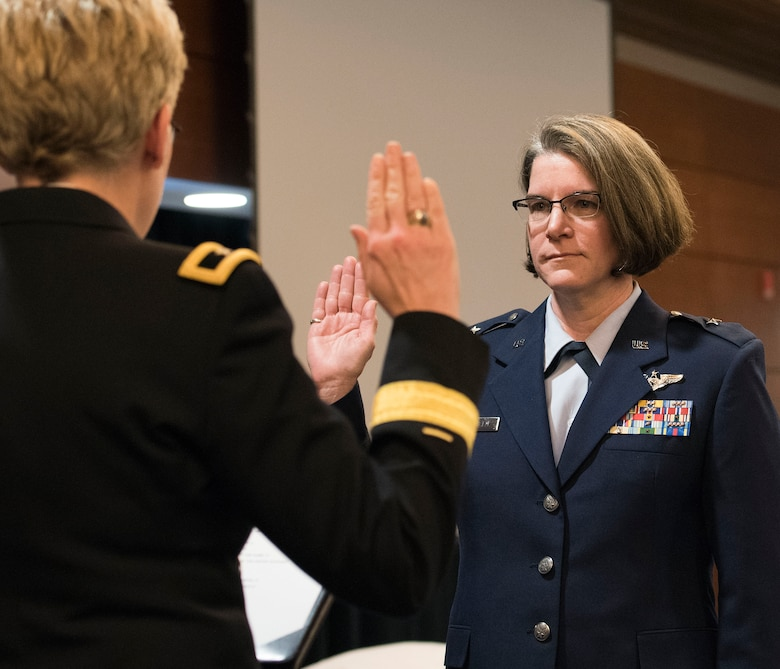 JOINT BASE ELMENDORF-RICHARDSON, Alaska -- Brig. Gen. Laurie Hummel (left), adjutant general of the state of Alaska, administers the Uniformed Services Oath of Office to newly-minted Brig. Gen. Karen Mansfield, commander of the Alaska Air National Guard, in a ceremony at the Arctic Warrior Events Center here March 6, 2016. Mansfield became the third female general officer in the history of the Alaska Air National Guard. National Guard photo by Capt. John Callahan.