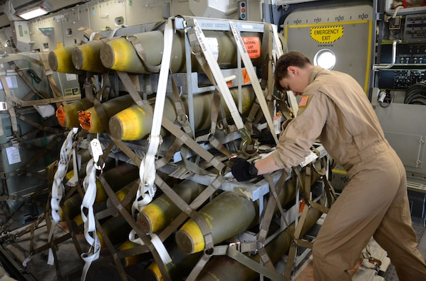 A deployed aircrew member pushes a pallet of munitions onto a C-17 Globemaster III at Al Udeid Air Base, Qatar, Feb. 26, 2016, in support of Operation Inherent Resolve. In February, the 8th Expeditionary Air Mobility Squadron loaded more than 3,500 tons of cargo onto U.S. aircraft. (U.S. Air Force photo/Tech. Sgt. James Hodgman)