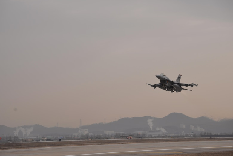 A 36th Fighter Squadron F-16 Fighting Falcon takes off prior to the start of readiness exercise Beverly Midnight 16-01 from Osan Air Base, Republic of Korea March 7, 2016. The exercise focuses on readiness, testing Osan's wartime procedures, and realistically looking at their ability to defend the base, execute operations and sustain follow-on forces. (U.S. Air Force photo by Staff Sgt. Benjamin Sutton/Released)