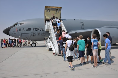 Approximately 200 American School of Doha students tour a KC-135 Stratotanker during a visit to Al Udeid Air Base, Qatar March 3. The students also received briefings on the aircraft's capabilities. During the visit, students watched a military working dog demonstration and met with U.S. Airmen from a variety of specialties. (U.S. Air Force photo by Tech. Sgt. James Hodgman/Released)