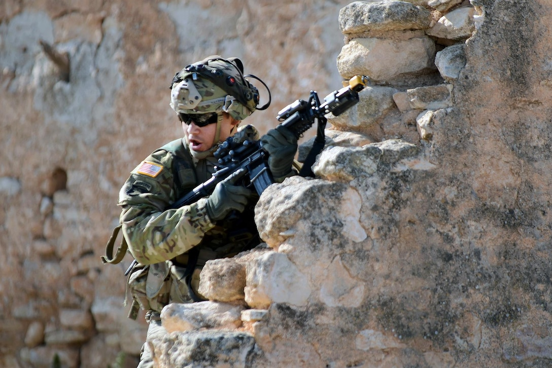 An Army paratrooper calls for support during Exercise Sky Soldier 16 at Chinchilla training area in Albacete, Spain, Feb. 29, 2016. Army photo by Staff Sgt. Opal Vaughn