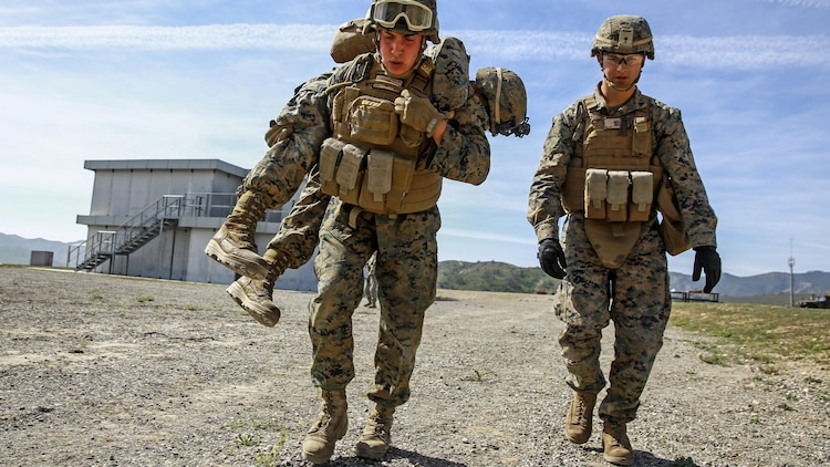 Marines execute a casualty evacuation drill during combat marksmanship training at Marine Corps Base Camp Pendleton March 2, 2016. The training was part of the Urban Leaders Course taught by 1st Marine Division Schools. The course focuses on enhancing small unit leadership through integrated training and implementation of fire teams and squad-sized elements in an urban setting. Marines participating in the training are from various units on Camp Pendleton.