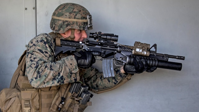 Lance Cpl. Parker Chase gets into position as the point man in his fire team during combat marksmanship training at Marine Corps Base Camp Pendleton, California, March 2, 2016. The training was part of the Urban Leaders Course taught by 1st Marine Division Schools.