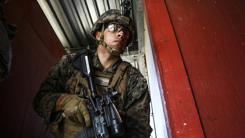 Lance Cpl. Roger Freckleton gets into position as the point man for his fire team during combat marksmanship training at Marine Corps Base Camp Pendleton March 2, 2016. The training was part of the Urban Leaders Course taught by 1st Marine Division Schools. The course focuses on enhancing small unit leadership through integrated training and implementation of fire teams and squad-sized elements in an urban setting. Freckleton is a scout rifleman with 1st Light Armored Reconnaissance Battalion, 1st Mar. Div., and a St. Augustine, Florida, native.