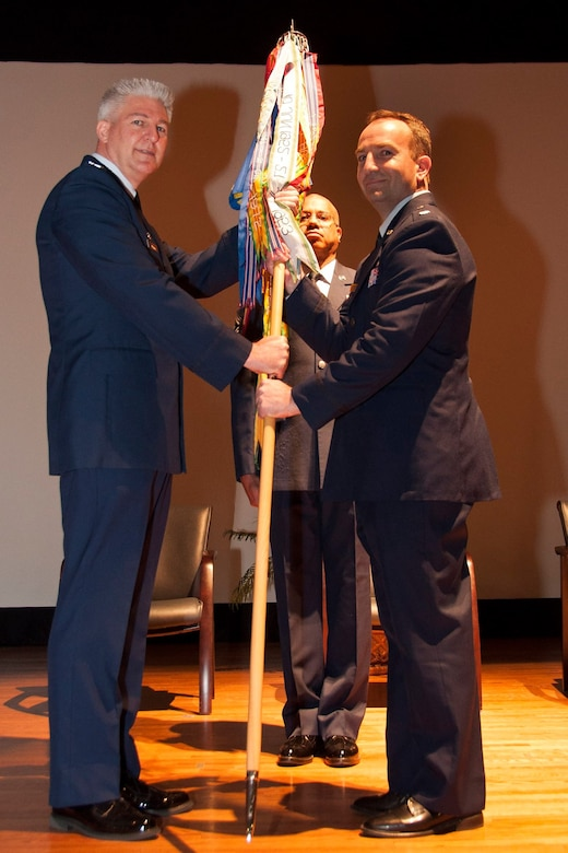 Lt. Col. Keith Eubanks, former 315th Maintenance Operations Flight commander (right),  accepts the squadron guidon from Col. Richard Gay, 315th MXG commander (left). Eubanks assumed command of the 315th MXS  during a  change of command ceremony at the base theater at JB Charleston, S.C.  (U.S. Air Force photo by Staff Sgt. Bobby Pilch)
