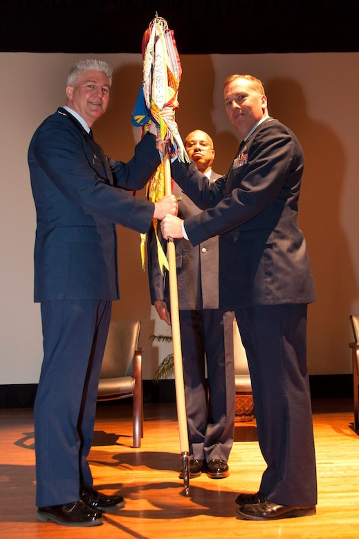 Lt. Col. Walter R. Fletcher (right), former commander of the 315th Maintenance Squadron passes the squadron guidon to Col. Richard Gay, 315th MXG commander (left). Lt. Col. Keith Eubanks, former 315th Maintenance Operations Flight commander assumed command of the 315th MXS  during a  change of command ceremony at the base theater at JB Charleston, S.C.  (U.S. Air Force photo by Staff Sgt. Bobby Pilch)