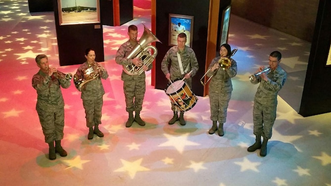 Wright Brass, part of the U.S. Air Force Band of Flight, performs the Air Force Song at the National Museum of the U.S. Air Force. This photo was taken during production of a video commemorating the 25th anniversary of Operation Desert Storm. (U.S. Air Force photo)