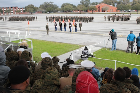 Honor Graduate stand ready to be relieved of their guide ons as educators watch from the stands March 4, 2016, aboard Marine Corps Recruit Depot Parris Island, S.C. The educators participated in a three-day workshop that afforded them the opportunity to experience a little of Marine Corps bootcamp. The workshop is to educate and inform educators about military service and life in the Marine Corps. (Official Marine Corps photo by Cpl. Diamond N. Peden/Released)