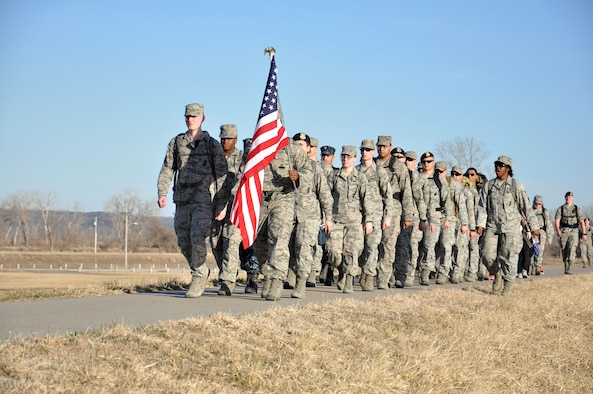 U.S. Air Force Senior Airman Abeni Claybrooks, 55th Security Forces Squadron, calls cadence for her flight March 5, 2016, during a ruck march from Haworth Park to the Base Lake and back in Bellevue, Neb. The six-mile ruck march was in honor of the late U.S. Air Force Staff Sgt. Micahel Bunten.