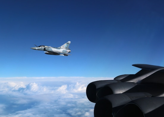 A French Air Force Mirage 2000 holds station off the wing of a U.S. Air Force B-52 Stratofortress in the skies over Northern France, March 1, 2016. The B-52 participated in an ad hoc friendly intercept during its flight to Norway for NATO exercise Cold Response 16. Friendly intercepts like these are often used as a training opportunity for both parties, and improve the coordination between military units. (U.S. Air Force courtesy photo/)