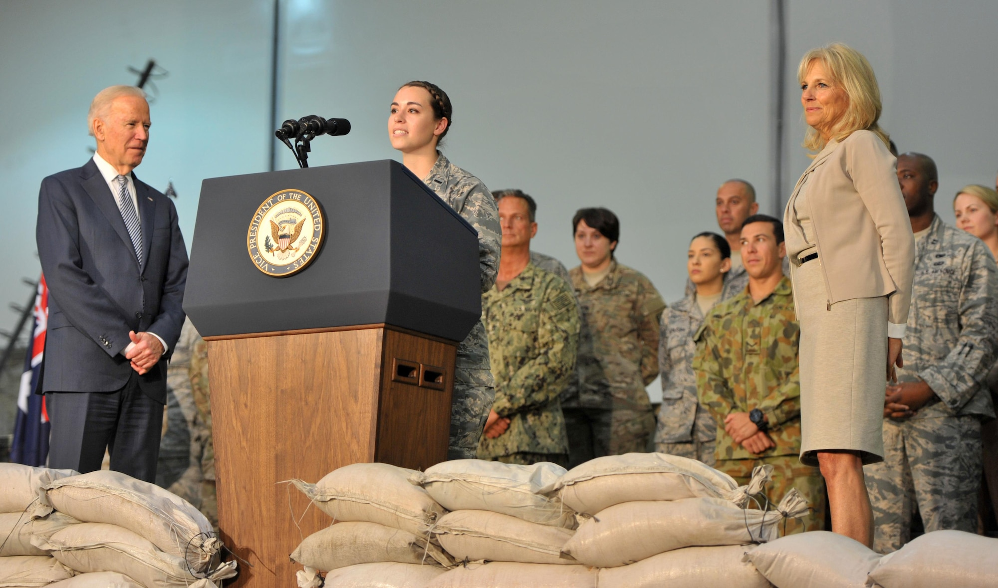 1st Lt. Karen, 380th Expeditionary Aircraft Maintenance Squadron officer in charge for the Sentry Aircraft Maintenance Unit, introduces Vice President Joe Biden to U.S. and coalition personnel during Biden's visit to an undisclosed location in Southwest Asia, March 7, 2016. Biden endorsed Karen's application to the Air Force Academy almost a decade ago before he accepted his current position as Vice President of the United States. (U.S. Air Force photo by Staff Sgt. Kentavist P. Brackin/released)