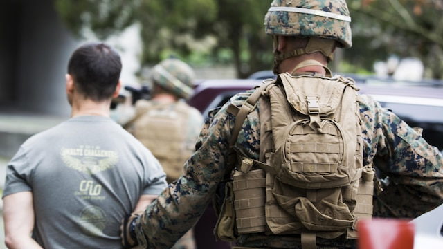 U.S. Marine Corps Lance Cpl. Noah S. Scalish, (right), automatic rifleman, 2nd platoon Bravo Company, 1st Battalion, 8th Marine Regiment, Special-Purpose Marine Air-Ground Task Force-Crisis Response-Africa escorts a simulated suspect during an active shooter exercise at U.S. Embassy, Lisbon, Portugal, Feb. 9, 2016. SPMAGTF-CR-AF conducts a scaled embassy reinforcement exercise at American Embassy Lisbon in coordination with the Regional Security Office and host nation security forces in order to enhance mission essential task proficiency and build relationships.