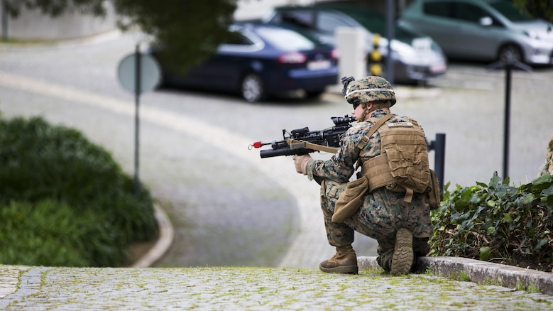U.S. Marine Corps Lance Cpl. Bradley C. Fryman, rifleman, 2nd platoon Bravo company, 1st Battalion, 8th Marine Regiment, Special-Purpose Marine Air-Ground Task Force-Crisis Response-Africa provides security during an active shooter exercise at U.S. Embassy, Lisbon, Portugal, Feb. 9, 2016. SPMAGTF-CR-AF conducts a scaled embassy reinforcement exercise at American Embassy Lisbon in coordination with the Regional Security Office and host nation security forces in order to enhance mission essential task proficiency and build relationships.