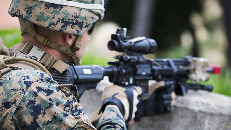 U.S. Marine Corps Lance Cpl. Noah S. Scalish, automatic rifleman, 2nd platoon, Bravo Company, 1st Battalion, 8th Marine Regiment, Special-Purpose Marine Air-Ground Task Force-Crisis Response-Africa provides security during an active shooter exercise at U.S. Embassy, Lisbon, Portugal, Feb. 9, 2016. SPMAGTF-CR-AF conducts a scaled embassy reinforcement exercise at American Embassy Lisbon in coordination with the Regional Security Office and host nation security forces in order to enhance mission essential task proficiency and build relationships.