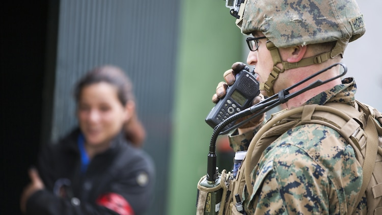 U.S. Marine Corps Cpl. Zeth N. Horr, squad leader, 2nd platoon Bravo Company, 1st Battalion, 8th Marine Regiment, Special-Purpose Marine Air-Ground Task Force-Crisis Response-Africa, radios in for medical assistance for a simulated casualty during an active shooter exercise at U.S. Embassy, Lisbon, Portugal, Feb. 9, 2016. SPMAGTF-CR-AF conducts a scaled embassy reinforcement exercise at American Embassy Lisbon in coordination with the Regional Security Office and host nation security forces in order to enhance mission essential task proficiency and build relationships.