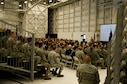 Col. Scott McLaughlin, commander of the 446th Airlift Wing, speaks to Airmen at a commander's call on Joint Base Lewis McChord, Wash., March 6. The 446th held Wingman Day after the commander's call to educate Airman on essential life skills. (U.S. Air Force Reserve photo by Staff Sgt. Daniel Liddicoet)
