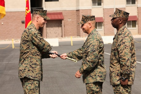 U.S. Marine Col. Vance L. Cryer, left, commanding officer of the 15th Marine Expeditionary Unit, takes the sword of office from Sgt. Maj. Douglas B. Schaefer, right, outgoing sergeant major of the 15th MEU, during a relief and appointment ceremony aboard Camp Pendleton, Calif., Mar. 4, 2016. The 15th MEU's relief and appointment ceremony signifies the passing of responsibility from Sgt. Maj. Douglas B. Schaefer to Sgt. Maj. Dennis K. Campbell. (U.S. Marine Corps photo by Sgt. Jamean R. Berry/Released)