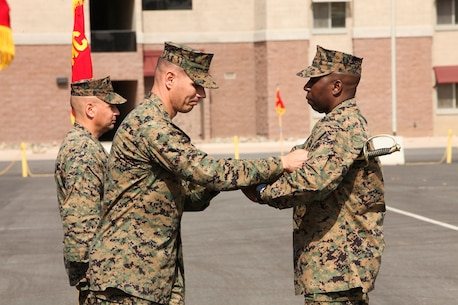 U.S. Marine Col. Vance L. Cryer, left, commanding officer of the 15th Marine Expeditionary Unit, presents the sword of office to Sgt. Maj. Dennis K. Campbell, right, incoming Sgt. Maj. of the 15th MEU, during a relief and appointment ceremony aboard Camp Pendleton, Calif., Mar. 4, 2016. The 15th MEU's relief and appointment ceremony signifies the passing of responsibility from Sgt. Maj. Douglas B. Schaefer to Sgt. Maj. Campbell. (U.S. Marine Corps photo by Sgt. Jamean R. Berry/Released)