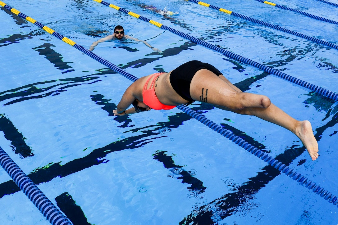A member of the U.S. Special Operations Command's adaptive sports program team dives into a pool during an event in Tampa, Fla., March 3, 2016. Veteran and active duty special operations forces are preparing for the 2016 Department of Defense Warrior Games in June. The sports program assists with the physical and mental recovery process, and works to improve the overall health and welfare of wounded, ill or injured troops. Air Force photo by Tech. Sgt. Angelita Lawrence