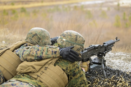Marines with Bravo Company, 2nd Law Enforcement Battalion, participated in familiarization training at Camp Lejeune, N.C., March 4, 2016, in order to improve their marksmanship skills with the M240 machine gun and M249 squad automatic weapon. The purpose of the shoot was to hone their accuracy, communication abilities and suppressive fire capabilities in order to prepare the unit for several upcoming training exercises. (U.S. Marine Corps photo by Lance Cpl. Aaron K. Fiala/Released)