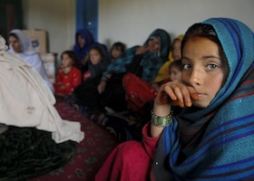 An Afghan girl attends a female engagement team meeting in Balish Kalay Village, Urgun District, Afghanistan (March 2011).