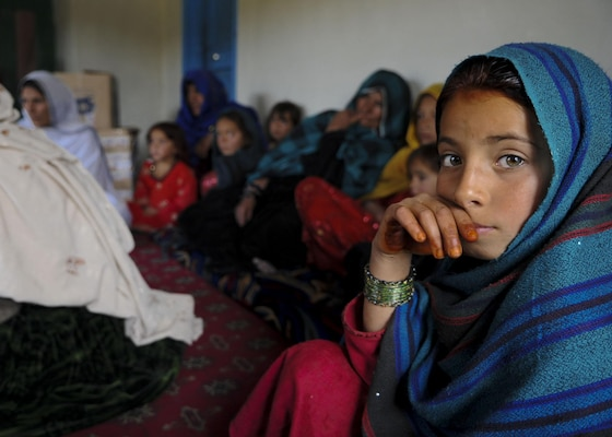 An Afghan girl attends a female engagement team meeting in Balish Kalay Village,