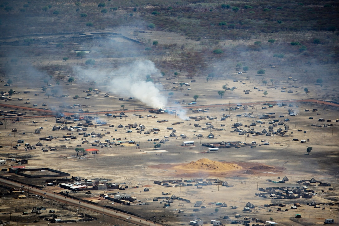 SUDAN, Abyei: A handout photo released by the United Nations Mission in Sudan (UNMIS) 23 March, shows burning homes in Abyei town. The UN said today that it strongly condemns the burning and looting currently being perpetrated by armed elements in Abyei following the seizure of the town by Northern Sudanese troops on 20 March. UNMIS PHOTO / STUART PRICE