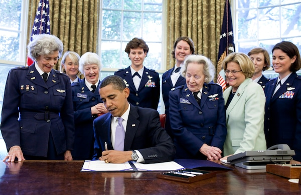 President Barack Obama signs S.614 in the Oval Office July 1. The bill awards a Congressional Gold Medal to Women Airforce Service Pilots. The WASP program was established during World War II, and from 1942 to 1943, more than a thousand women joined, flying sixty million miles of non-combat military missions.  Of the women who received their wings as Women Airforce Service Pilots, approximately 300 are living today. (Official White House photo/Pete Souza)