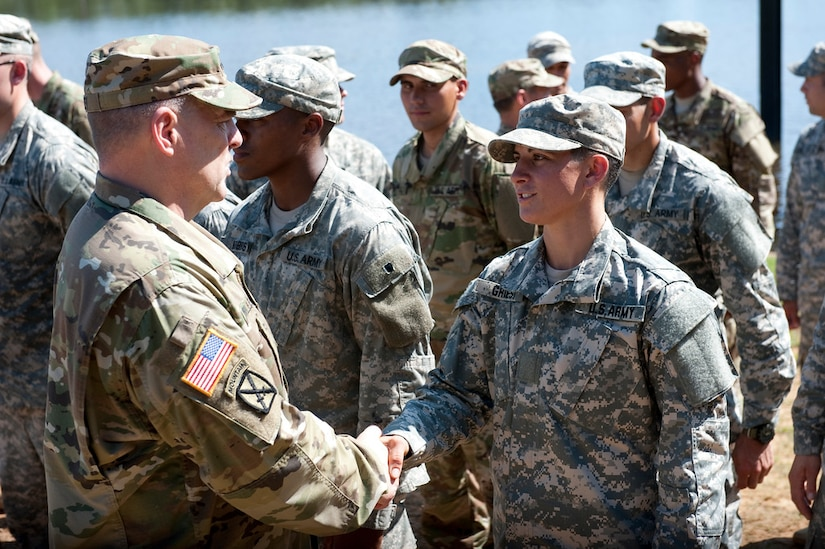 Army Chief of Staff Mark A. Milley shakes hands with Capt. Kristen M. Griest, one of the latest Soldiers to earn the Ranger tab (Aug. 21, 2015).