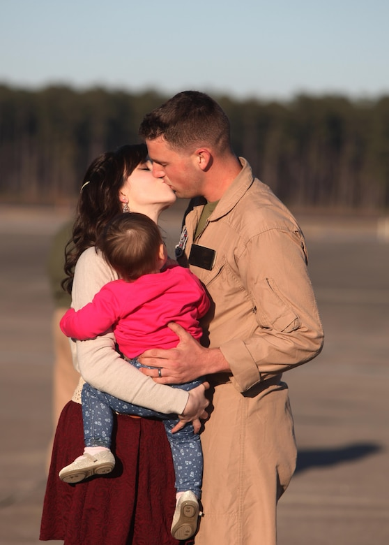 Cpl. Corey Wright greets his family at Marine Corps Air Station Cherry Point, N.C., Jan. 21, 2016. The Marines deployed to Africa and Spain, where they assisted the Personnel Recovery Task Force by working hand-in-hand with other United States military branches. The mission focused on the skills and abilities of service members to successfully reintegrate and recover isolated personnel. On Jan. 13, VMGR-252 welcomed home another detachment, who remained in Moron, Spain. In total the detachment's Marines moved over 2,900 passengers, 778,000 pounds of cargo and delivered 845,000 pounds of fuel to receiver aircraft. Wright is a fixed-wing aircraft crew chief with VMGR-252. (U.S. Marine Corps photo by Cpl. Unique Roberts/ Released)
