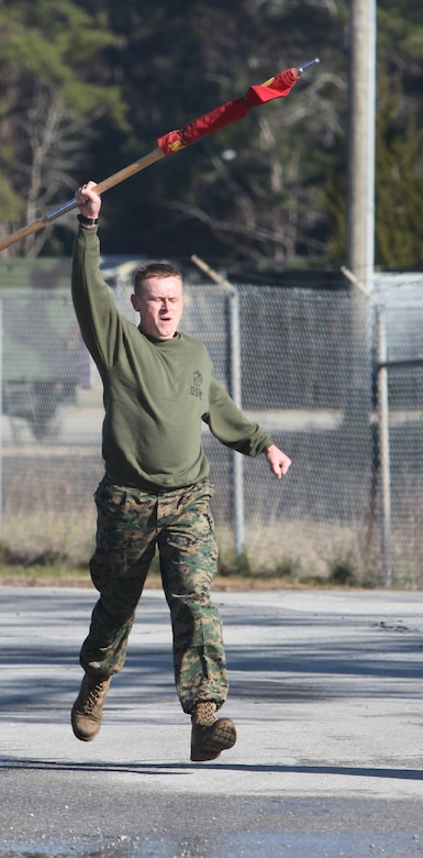 Captain Ronnie Creech runs to the finish line during Marine Wing Communication Squadron 28's semi-annual Spartan Cup field meet at Marine Corps Air Station Cherry Point, N.C., Jan. 29. The Marines competed in various activities, including tug-of-war and the running of the ranks, in which the three companies battled head-to-head to win the squadron's Spartan Cup. The field meet is held to further strengthen esprit de corps and unit cohesion within the squadron, and to foster a sense of unit pride while improving Marines' overall readiness. Creech is the company commander for Company A, MWCS-28. (U.S. Marine Corps photo by Cpl. Unique Roberts/ Released)