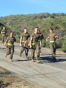 Corporals of Class 349-16 execute the 3.8 Mile Casualty Evacuation course aboard Camp Pendleton California.