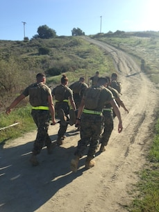 Corporals of Class 349-16 attack the final hill of the Casualty Evacuation simulation training event aboard Camp Pendleton California.