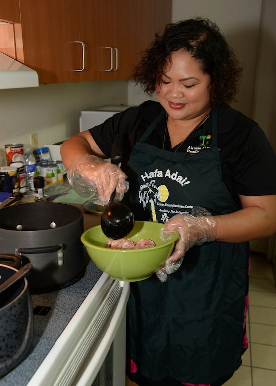 Hope Cortez, 36th Force Support Squadron Airman and Family Readiness Center work life consultant, prepares a dish during a Chamorro History Month cooking demonstration March 4, 2016, at Andersen Air Force Base, Guam. Throughout the month of March, the A&FRC will be hosting a variety of classes and activities surrounding local culture, customs and traditions. (U.S. Air Force photo/Senior Airman Cierra Presentado)