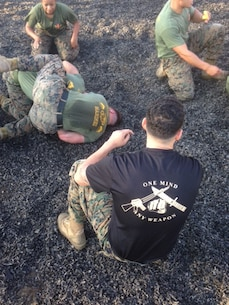 Sergeant Robles of 1st TSB, a Martial Arts Instructor, observes proper techniques are applied and tap out procedures are followed.