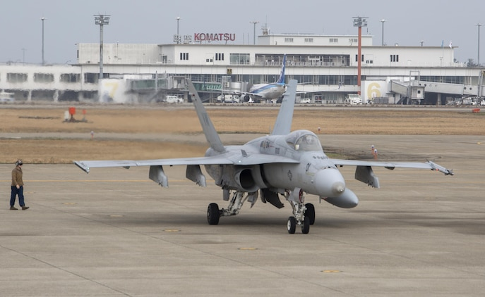 """An FA-18A++ Hornet with Marine Fighter Attack Squadron (VMFA) 314, forward deployed to Marine Corps Air Station Iwakuni, Japan, arrives at Komatsu Air Base, Japan, for the Komatsu Aviation Training Relocation exercise March 7, 2016. VMFA-314, also known as the """"Black Knights,"""" took the lead in conducting dissimilar air combat training and bilateral tactical mission training with the Japan Air Self-Defense Force. Every ATR contributes to U.S. and Japan forces' understanding of each other's capabilities and methods by fostering peace and stability through increased interoperability. (U.S. Marine Corps photo by Cpl. Nicole Zurbrugg/Released)"""