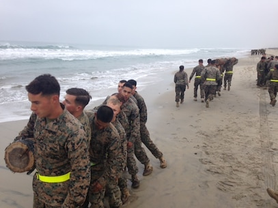 5th Squad of Corporals Course 349-16 conducts side benders as squads depart throughout the 4 mile course along Del Mar 