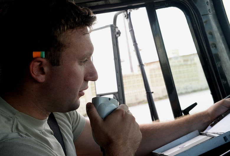 Airman 1st Class Nicholas Blanchette, 36th Logistics Readiness Squadron Fuels Management Flight mobile distributor, receives a refuel request via radio Feb. 26, 2016, at Andersen Air Force Base, Guam. Fuels management technicians  service all aircraft, machinery and vehicles on Andersen AFB with the fuel needed to ensure the mission never stops. (U.S. Air Force photo/Airman 1st Class Alexa Ann Henderson)