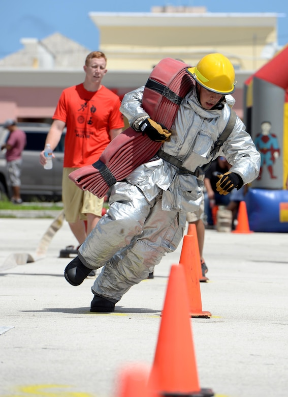 Airman 1st Class Jared May, 36th Civil Engineer Squadron fire protection crew chief, navigates through an obstacle during the annual Guam Fire Muster competition March 5, 2016, in Hagåtña, Guam. The competition simulated obstacles and challenges firefighters could face when responding to an emergency. (U.S. Air Force photo/Staff Sgt. Benjamin Gonsier)
